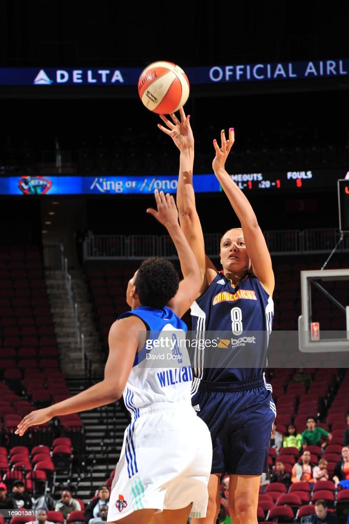 Mistie Bass #8 of the Connecticut Sun soots against Kamiko Williams #4 of the New York Liberty during the WNBA game on May 18, 2013 at the Prudential Center in Newark, New Jersey.