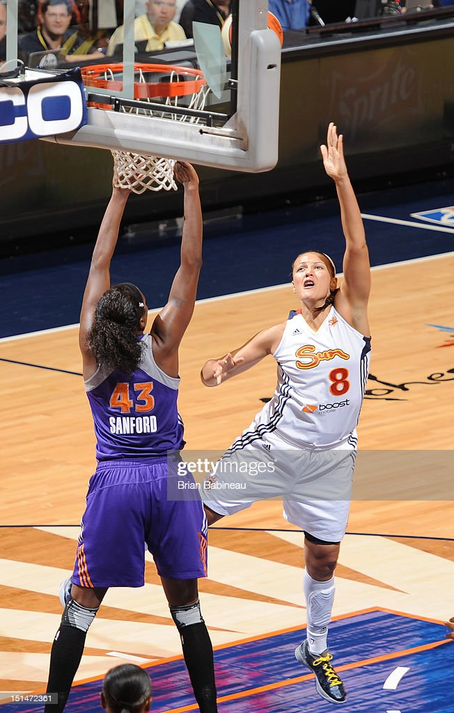 Mistie Mims of the Connecticut Sun shoots over Nakia Sanford of the Phoenix Mercury on September 7 2012 at Mohegan Sun Arena in Uncasville...