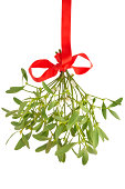 Mistletoe bunch hanging from a red ribbon isolated on white XXXL