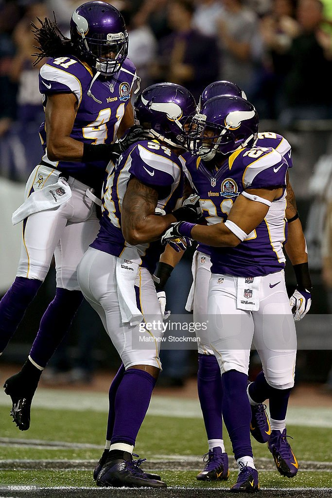 Mistral Raymond #41, Jasper Brinkley #54, A.J. Jefferson #24 and Josh Robinson #21 of the Minnesota Vikings celebrate a Robinson interception against the Chicago Bears at Mall of America Field on December 9, 2012 in Minneapolis, Minnesota.