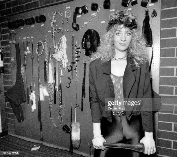 Mistress Catrina stands in front of a display of play things used at The Blue Velvet on 7575 N Broadway These items are used for clients who come...