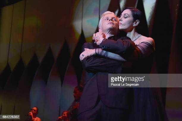 Mistress Of Ceremonies Monica Bellucci and French comedian Alex Lutz dance during the Opening Ceremony of the 70th annual Cannes Film Festival at...