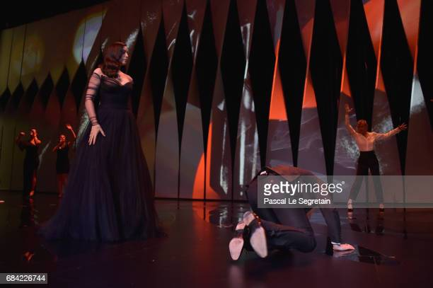 Mistress Of Ceremonies Monica Bellucci and French comedian Alex Lutz during the Opening Ceremony of the 70th annual Cannes Film Festival at Palais...