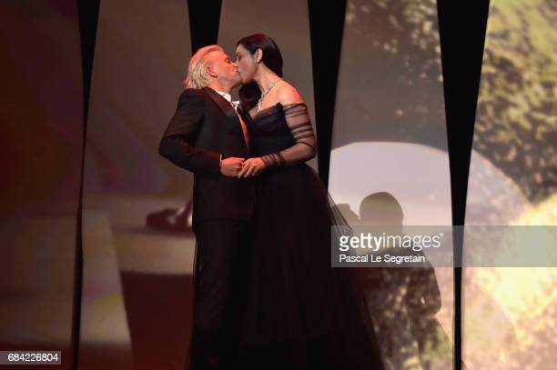 Mistress Of Ceremonies Monica Bellucci and French comedian Alex Lutz kiss during the Opening Ceremony of the 70th annual Cannes Film Festival at...