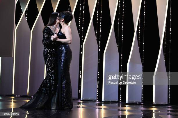 Mistress of Ceremonies Monica Bellucci greets actress Juliette Binoche during the Closing Ceremony during the 70th annual Cannes Film Festival at...