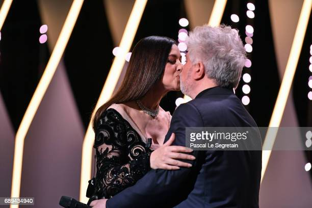 Mistress of Ceremonies Monica Bellucci greets with President of the jury Pedro Almodovar on stage during the Closing Ceremony of the 70th annual...