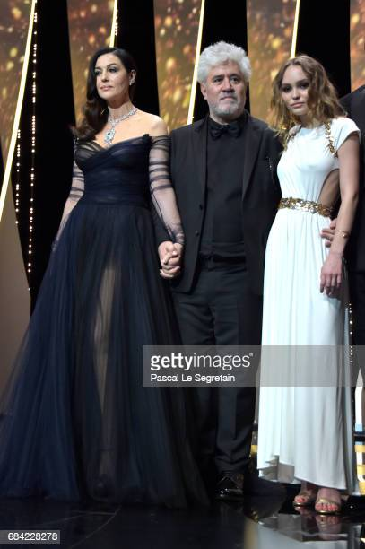 Mistress Of Ceremonies Monica Bellucci President of the jury Pedro Almodovar and model LilyRose Depp during the Opening Ceremony of the 70th annual...