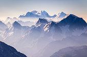 Misty blue mountains on sunrise