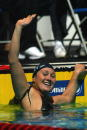 Misty Hyman reacts to winning the WOmen's 100M Butterfly Final during the US Swimming National Championships at the IU Natatorium on April 4 2003 in...