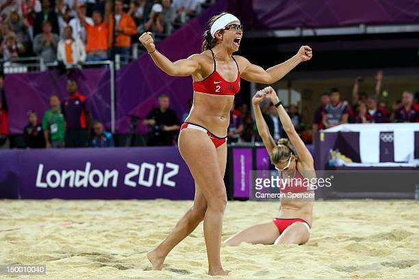Misty MayTreanor and Kerri Walsh Jennings of the United States celebrate winning the Gold medal in the Women's Beach Volleyball Gold medal match...