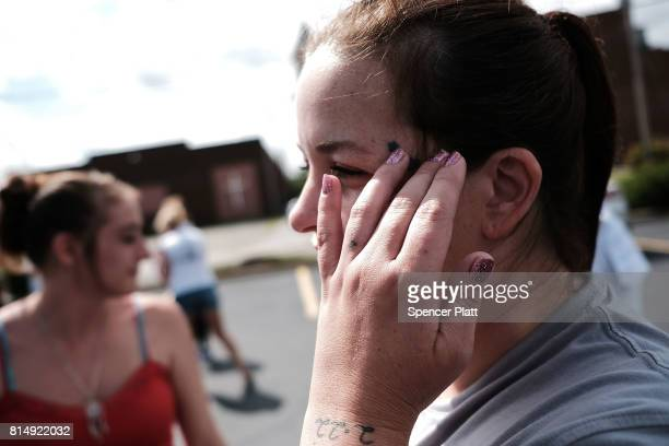 Misty Morgan a recovered heroin addict attends a march through the streets of Norwalk against the epidemic of heroin in the community on July 14 2017...