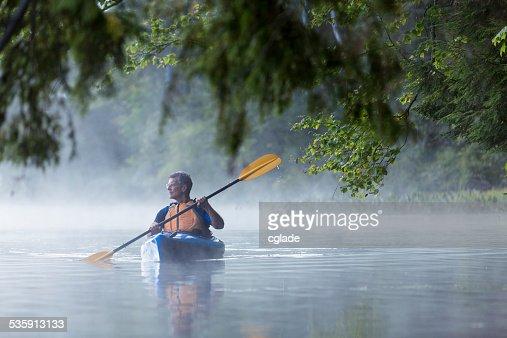 Misty morning kayaking : Stock Photo