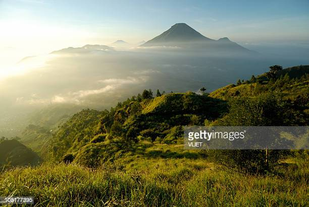 Misty mountain and volcano landscape in Indonesia at sunrise