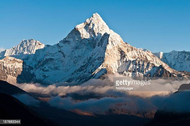 Misty mountain high glorious snow capped pinnacle Himalayas Nepal