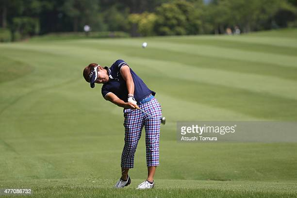 Misuzu Narita of Japan hits her second shot on the 15th hole during the Suntory Ladies Open at the Rokko Kokusai Golf Club on June 14 2015 in Kobe...