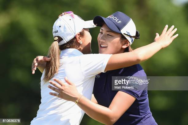 Misuzu Narita of Japan hugs Asako Fujimoto of Japan during the second round of the Nipponham Ladies Classics at the Ambix Hakodate Club on July 8...