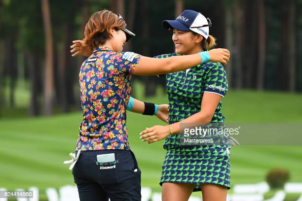 Misuzu Narita of Japan hugs with Lala Anai after a winning putt on the 18th green during the Daito Kentaku Eheyanet Ladies 2017 at the Narusawa Golf...