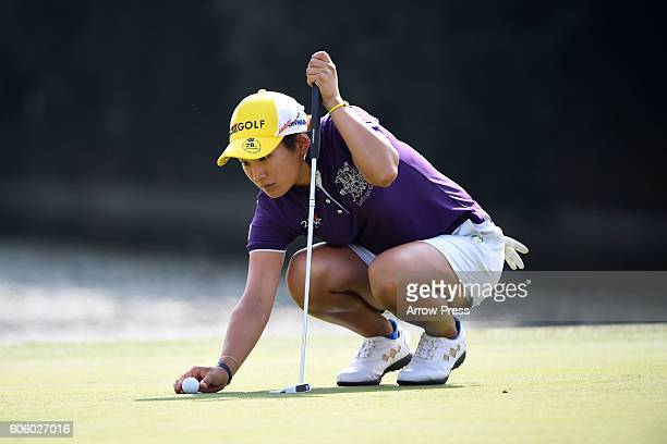 Misuzu Narita of Japan lines up her putt on the 18th green during the first round of the Munsingwear Ladies Tokai Classic 2016 at the Shin Minami...