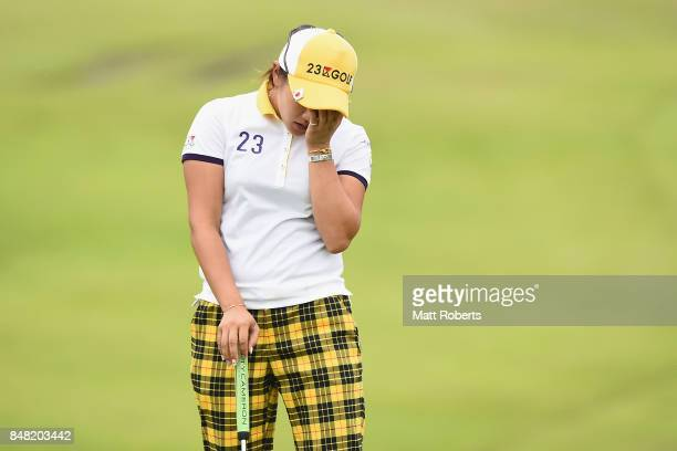 Misuzu Narita of Japan looks dejected after her putt on the 18th green during the final round of the Munsingwear Ladies Tokai Classic 2017 at the...