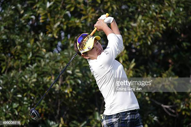 Misuzu Narita of Japan plays a tee shot on the 3rd hole during the third round of the LPGA Tour Championship Ricoh Cup 2015 at the Miyazaki Country...