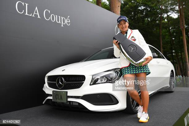 Misuzu Narita of Japan poses with the prize car after winning the Daito Kentaku Eheyanet Ladies 2017 at the Narusawa Golf Club on July 30 2017 in...