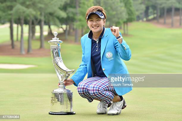 Misuzu Narita of Japan poses with the trophy after winning the Suntory Ladies Open at the Rokko Kokusai Golf Club on June 14 2015 in Kobe Japan