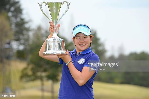 Misuzu Narita of Japan poses with the trophy after winning the Studio Alice Open at the Hanayashiki Golf Club Yokawa Course on April 12 2015 in Miki...