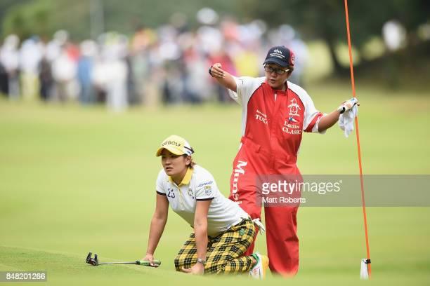 Misuzu Narita of Japan prepares to putt on the 15th green during the final round of the Munsingwear Ladies Tokai Classic 2017 at the Shin Minami...