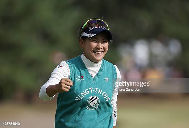 Misuzu Narita of Japan reacts after a putt on the 18th green during the first round of the LPGA Tour Championship Ricoh Cup 2015 at the Miyazaki...