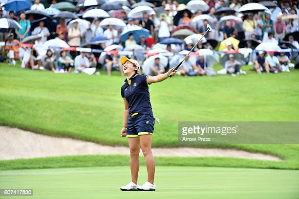 Misuzu Narita of Japan reacts after missing her putt on the 18th green during the Final round of the Munsingwear Ladies Tokai Classic 2016 at the...