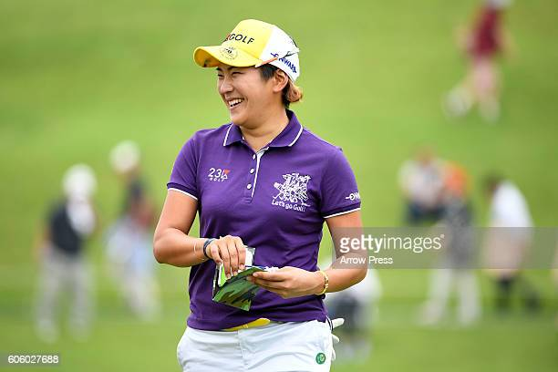 Misuzu Narita of Japan smails during the first round of the Munsingwear Ladies Tokai Classic 2016 at the Shin Minami Aichi Country Club Mihama Course...
