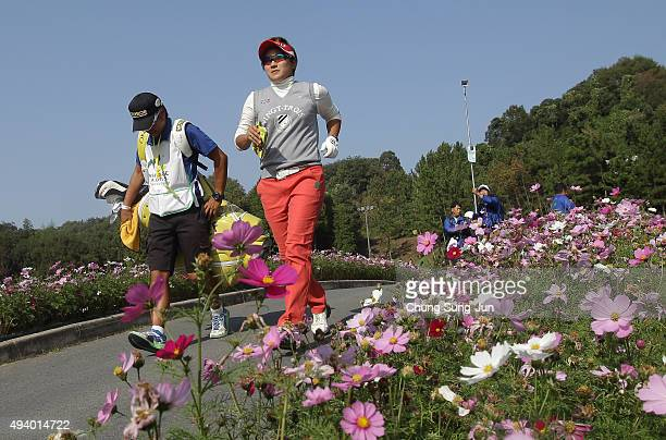 Misuzu Narita of Japan walks on the 16th green during the third round of the Nobuta Group Masters GC Ladies at the Masters Gold Club on October 24...