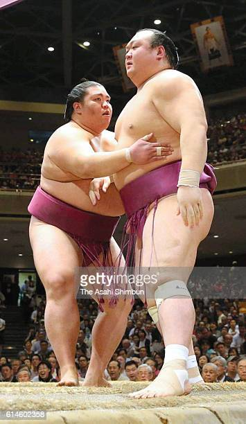 Mitakeumi pushes Takarafuji out of the ring to win during final day of the Grand Sumo Autumn Tournament at Ryogoku Kokugikan on September 25 2016 in...