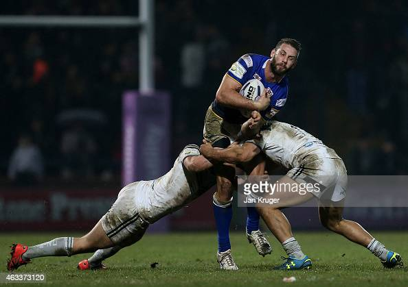 Mitch Achurch of Leeds Rhinos is tackled during the First Utility Super League match between Leeds Rhinos and Widnes Vikings at Headingley Carnegie...