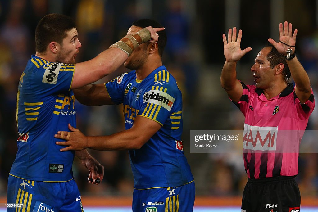 Mitch Allgood of the Eels is held back by <a gi-track='captionPersonalityLinkClicked' href=/galleries/search?phrase=Jarryd+Hayne&family=editorial&specificpeople=563352 ng-click='$event.stopPropagation()'>Jarryd Hayne</a> of the Eels as he gestures after referee Ashley Klein sends him to the sin bin for ten minutes for fighting on during the round nine NRL match between the Parramatta Eels and the Brisbane Broncos at Parramatta Stadium on May 11, 2013 in Sydney, Australia.