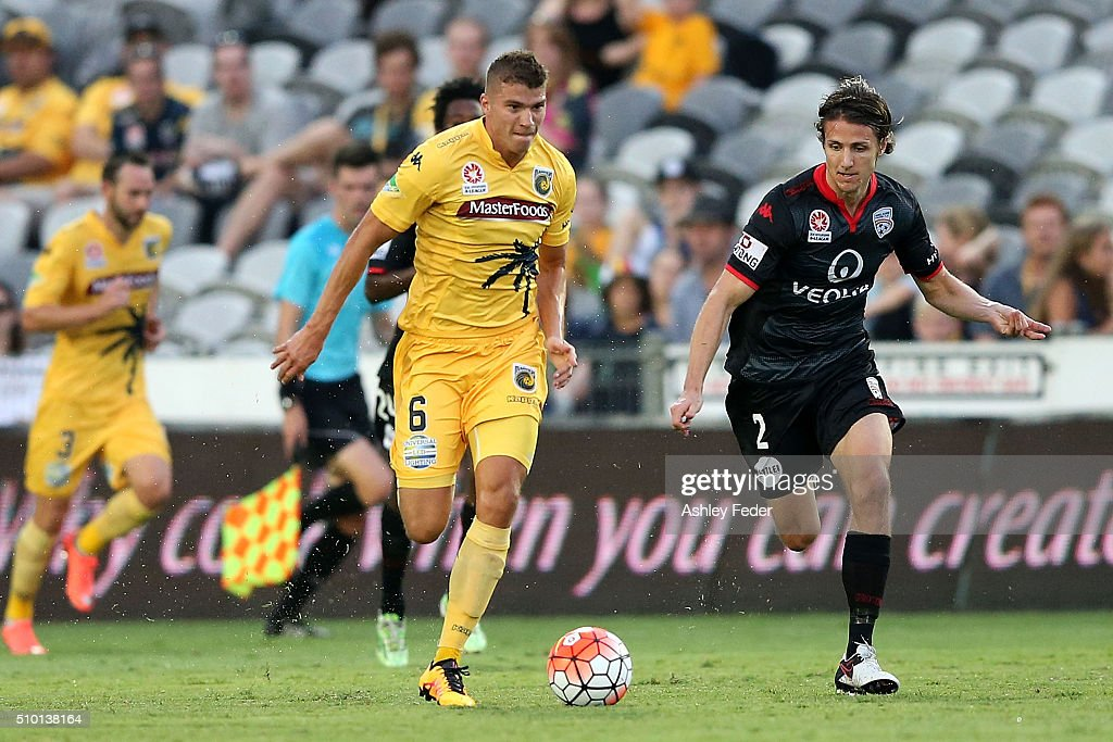 Mitch Austin of the Mariners controls the ball ahead of Michael Marrone of Adelaide United during the round 19 A-League match between the Central Coast Mariners and Adelaide United at Central Coast Stadium on February 14, 2016 in Gosford, Australia.
