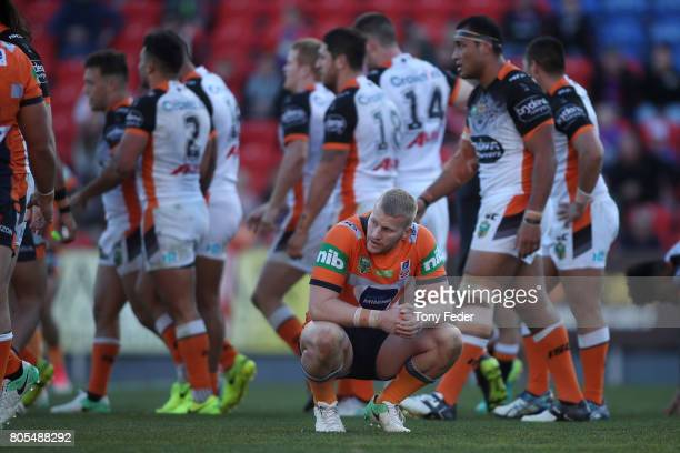 Mitch Barnett of the Knights looks dejected after losing to the Tigers during the round 17 NRL match between the Newcastle Knights and the Wests...