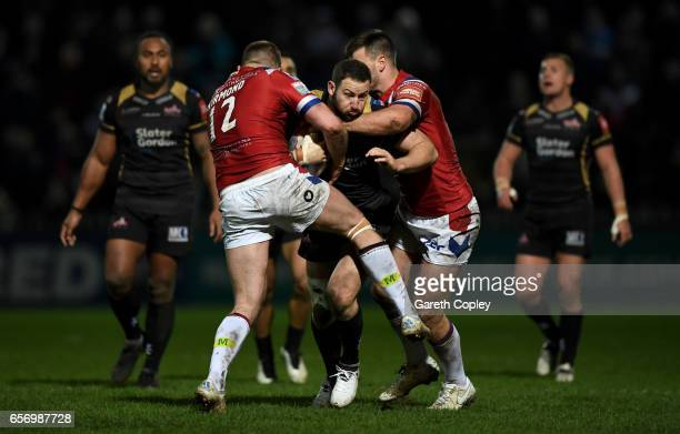 Mitch Brown of Leigh is tackled by Danny Kirmond of Wakefield during the Betfred Super League match between Wakefield Trinity and Leigh Centurions at...