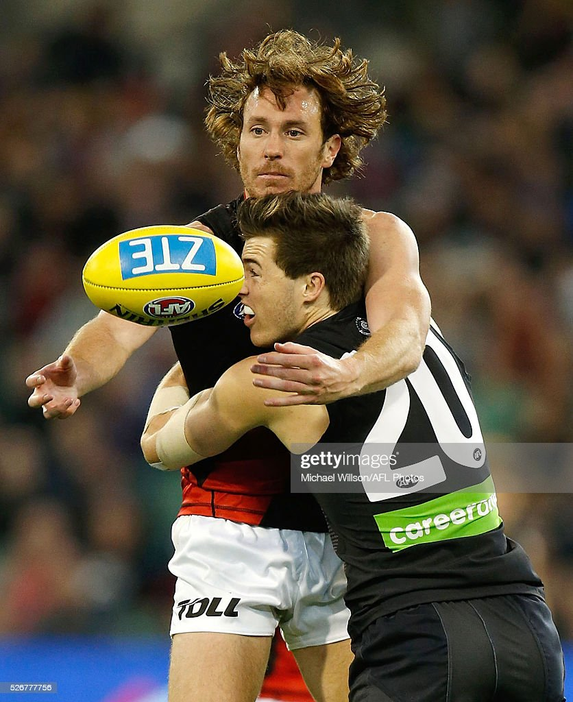 Mitch Brown of the Bombers is tackled by Lachie Plowman of the Blues during the 2016 AFL Round 06 match between the Carlton Blues and the Essendon Bombers at the Melbourne Cricket Ground, Melbourne on May 1, 2016.