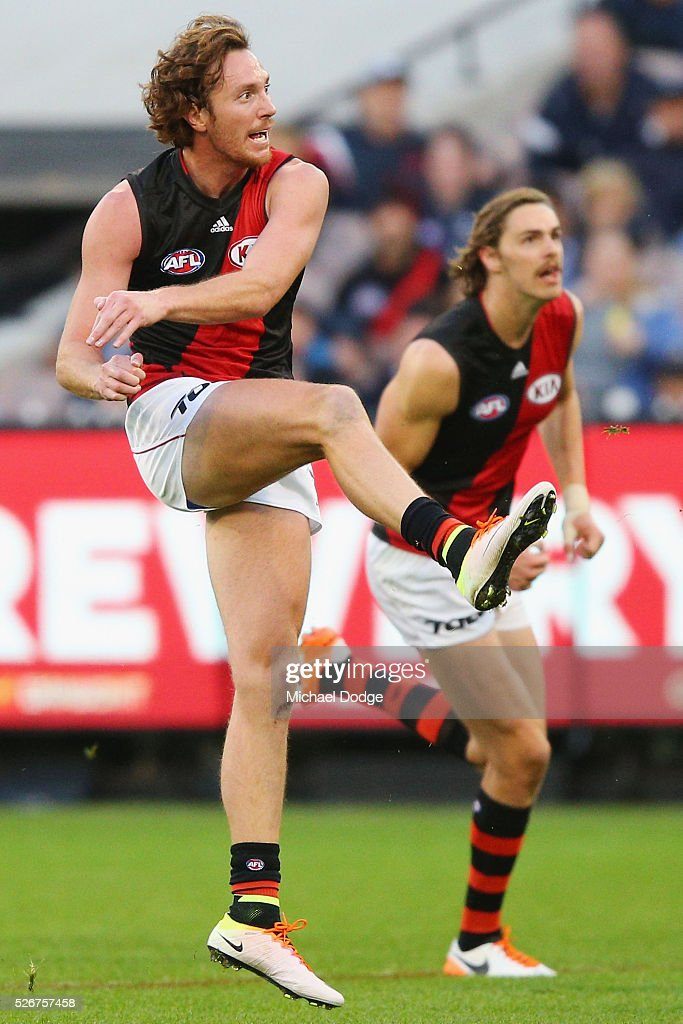 Mitch Brown of the Bombers kicks the ball towards goal during the round six AFL match between the Carlton Blues and the Essendon Bombers at Melbourne Cricket Ground on May 1, 2016 in Melbourne, Australia.