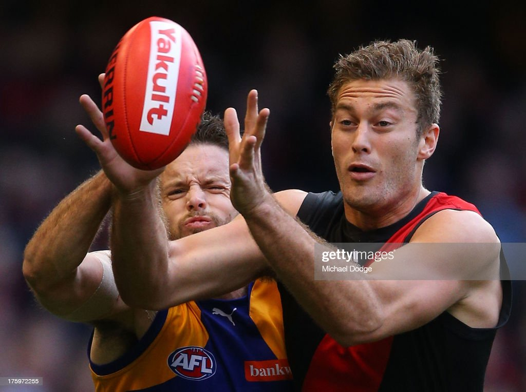 Mitch Brown (L) of the Eagles and Tom Bellchambers of the Bombers contest for the ball during the round 20 AFL match between the Essendon Bombers and the West Coast Eagles at Etihad Stadium on August 11, 2013 in Melbourne, Australia.