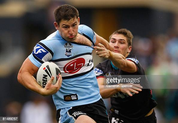 Mitch Brown of the Sharks is tackled during the round 13 NRL match between the Penrith Panthers and the CronullaSutherland Sharks at CUA Stadium on...