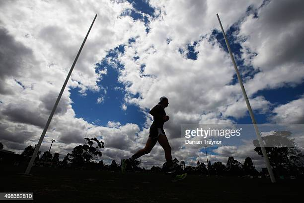 Mitch Clark of the Cats runs laps during a Geelong Cats AFL preseason training session at Kardinia Park on November 23 2015 in Melbourne Australia