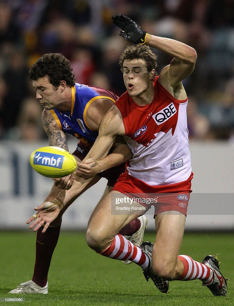 Mitch Clark of the Lions and Mike Pyke of the Swans compete for the ball during the round 22 AFL match between the Brisbane Lions and the Sydney Swans at The Gabba on August 28, 2010 in Brisbane, Australia.