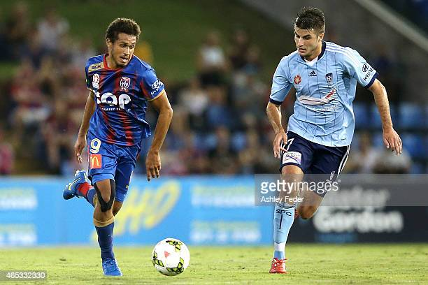 Mitch Cooper of the Jets contests the ball against Terry Antonis of Sydney FC during the round 20 ALeague match between the Newcastle Jets and Sydney...