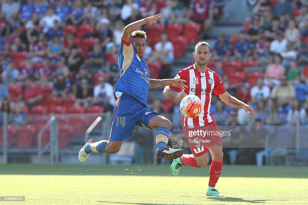 Mitch Cooper of the Jets contests the ball with Ivan Franjic of Melbourne City during the round 18 A-League match between the Newcastle Jets and Melbourne City FC at Hunter Stadium on February 7, 2016 in Newcastle, Australia.
