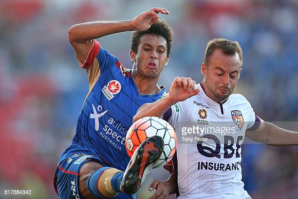 Mitch Cooper of the Jets contests the ball with Marc Warren of the Glory during the round 25 ALeague match between the Newcastle Jets and the Perth...