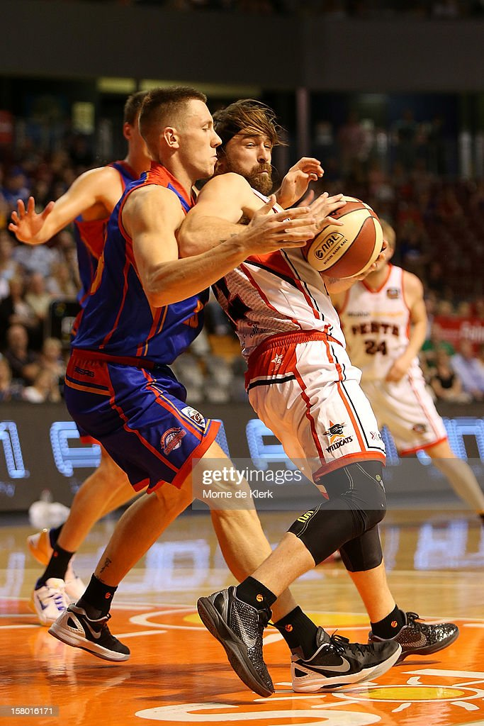 Mitch Creek of Adelaide steals the ball from Brad Robbins of Perth during the round ten NBL match between the Adelaide 36ers and the Perth Wildcats at Adelaide Arena on December 9, 2012 in Adelaide, Australia.