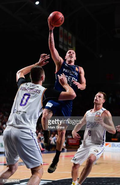 Mitch Creek of the 36ers makes a basket over Isaac Humphries of the Sydney Kings during the round seven NBL match between Adelaide 36ers and the...