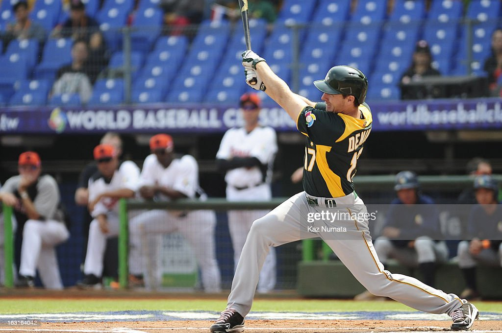 Mitch Dening #17 of Team Australia singles in the top of the first inning during Pool B, Game 5 between Team Australia and Team Netherlands during the first round of the 2013 World Baseball Classic at Taichung Intercontinental Baseball Stadium on Tuesday, March 5, 2013 in Taichung, Taiwan.